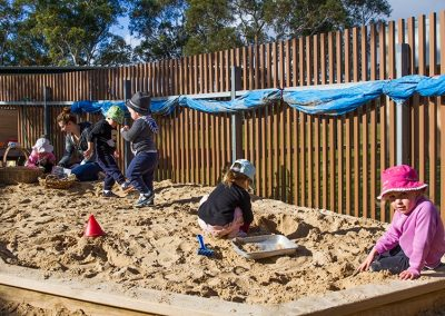 Kids playing and learning in the sandpit